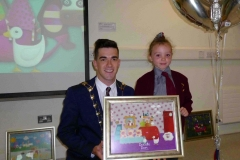 The Mayor of South Dublin County Fintan Warfield with Aoibheann Coyne (1000th child) from St. Brigid's Junior National School at the 1000th child to enroll in Doodle Den, and launch of www.doodleden.ie, on International Literacy Day 2014.